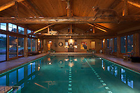 Stock image of residential swimming pool Twilight shot of residential swimming pool Luxury pool house