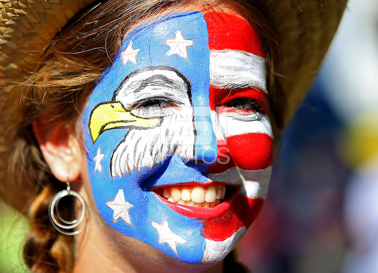 A USA fan with painted face soaks up the atmosphere outside the Arena Fonte Nova ahead of kick off