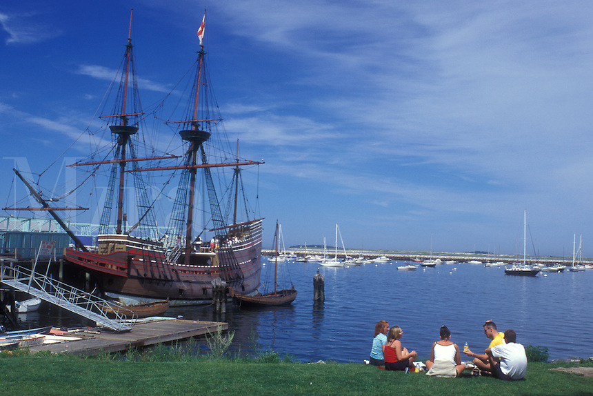 AJ0012, Plymouth, Massachusetts, Atlantic Ocean, A family picnics on the lawn overlooking the Plymouth Harbor. The Mayflower II is docked in the harbor.