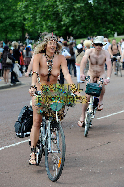 ATMOSPHERE .Cyclists takes part in the annual 'London World Naked Bike Ride' event in Westminster, London, England..June 12th, 2010.gv general view nude flashing skin full length paint nipples breasts cleavage  penis  bicycle.CAP/IA.©Ian Allis/Capital Pictures.