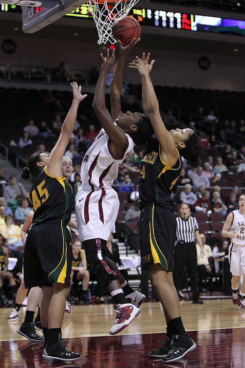March 4, 2011; Las Vegas, NV, USA; Santa Clara Broncos forward Lena Gipson (center) grabs a rebound against San Francisco Dons guard Mel Khlok (45) and forward Bailey Barbour (right) during the WCC Basketball Championships at Orleans Arena. The Broncos defeated the Dons 62-58.
