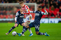 11th January 2020; Bet365 Stadium, Stoke, Staffordshire, England; English Championship Football, Stoke City versus Milwall FC; Mahlon Romeo of Millwall tackles James McClean of Stoke City - Strictly Editorial Use Only. No use with unauthorized audio, video, data, fixture lists, club/league logos or 'live' services. Online in-match use limited to 120 images, no video emulation. No use in betting, games or single club/league/player publications