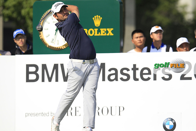 Alexander Levy (FRA) tees off the 10th tee during Sunday's Final Round of the 2014 BMW Masters held at Lake Malaren, Shanghai, China. 2nd November 2014.<br /> Picture: Eoin Clarke www.golffile.ie