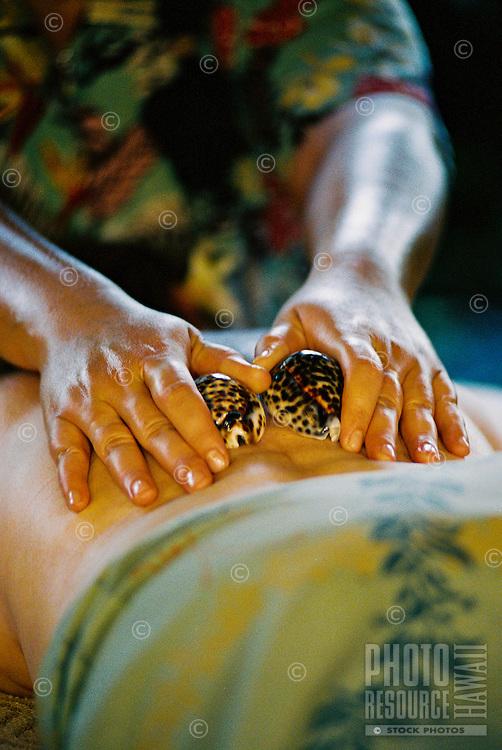 Woman recieving Hawaiian shell treatment at the Mauna Lani spa on the Big Island of Hawaii
