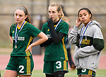 MIDDLETOWN, CT-111817JS34- Holy Cross' McKenna Ellsworth (2), Erin Goggin (3) and Jasmine Thorpe (5), look on as Old Lyme receives their championship medals following their Class S state final game Saturday at Middletown High School.<br /> Jim Shannon Republican-American