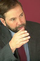 may 27, 2003, Montreal, Quebec, Canada.<br /> <br /> Thomas J Mulcair, Quebec new Environment Minister, speak at a press conference to disclose the trial use of Bio Diesel (H 20)for the last 6 months,<br />  by the Transit Commission in Montreal (SociÈtÈ de Transport de MontrÈal) ,  May 28, 2003.<br /> <br /> If done on a regular basis, it would help reduce pollution by city buses.<br /> <br /> <br /> Mandatory Credit: Photo by Pierre Roussel- Images Distribution. (©) Copyright 2003 by Pierre Roussel