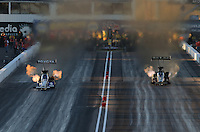 Feb. 22, 2013; Chandler, AZ, USA; NHRA top fuel dragster driver Antron Brown (left) races alongside Khalid Albalooshi during qualifying for the Arizona Nationals at Firebird International Raceway. Mandatory Credit: Mark J. Rebilas-