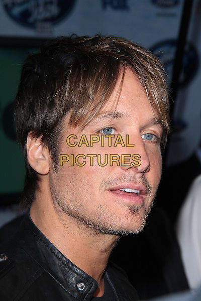 LOS ANGELES, CA - February 20: Keith Urban at the American Idol XIII Finalists Party, Fig &amp; Olive, Los Angeles,  February 20, 2014. <br /> CAP/MPI/JO<br /> &copy;Janice Ogata/MediaPunch/Capital Pictures