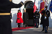 United States President Barack Obama, center, and First Lady Michelle Obama arrive to attend an arrival ceremony for President Francois Hollande of France on the South Lawn of the White House in Washington, D.C., U.S., on Tuesday, Feb. 11, 2014. <br /> Credit: Andrew Harrer / Pool via CNP