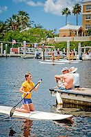 A large crowd cheered as their favorite contestants paddled a one mile course in Bayfront Marina during  the first annual 'Stand Up Paddleboard Races and Luau' held to raise funds for Special Olympics of Collier County, at Bayfront Marina, Naples, Florida, USA, Saturday, May 22, 2010.  Photo by Debi Pittman Wilkey