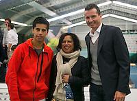 19-01-14,Netherlands, Rotterdam,  TC Victoria, Wildcard Tournament, ,   Final,   Fabian van der Lans (NED) (L) with his mother and Tournament director Richard Krajicek.<br /> Photo: Henk Koster