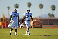 Sept. 16, 2009; Casa Grande, AZ, USA; California Redwoods nose tackle (74) Steve Edwards and offensive tackle (78) Todd Williams head to the field during training camp at the Casa Grande Training Facility & Performance Institute. Mandatory Credit: Mark J. Rebilas-