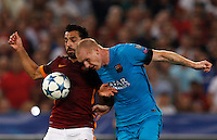 Calcio, Champions League, Gruppo E: Roma vs Barcellona. Roma, stadio Olimpico, 16 settembre 2015.<br /> Roma&rsquo;s Mohamed Salah, left, and FC Barcelona&rsquo;s Jeremy Mathieu compete for the ball during a Champions League, Group E football match between Roma and FC Barcelona, at Rome's Olympic stadium, 16 September 2015.<br /> UPDATE IMAGES PRESS/Riccardo De Luca