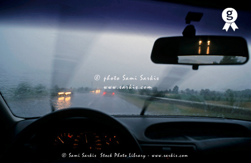 Inside a speeding car on a highway under rain, Provence, France (Licence this image exclusively with Getty: http://www.gettyimages.com/detail/82406733 )