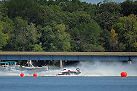 Frame 1: Dan Orchard, (#97) spins and rolls over in the East Turn. (SST-120 class)