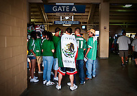 Fans wearing the Mexican flag enter the Cotton Bowl Stadium where Mexico played Colombia in an exhibition game in Dallas, Texas, USA, Wednesday, Sept., 30, 2009. Colombia won the game 2-1, which was played as the second game of a double header after an FC Dallas soccer game in an attempt by Major League Soccer to draw a new crowd of hispanic people to the sport in the US...PHOTOS/ MATT NAGER