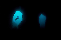 RS0235-D. scuba diver (model released) silhouetted in one of the many openings to Cathedral Cave, also called Skull Cave, the largest sea cave system in Australia. Waterfall Bay, Tasman Peninsula. Tasmania, Australia, Pacific Ocean.<br /> Photo Copyright &copy; Brandon Cole. All rights reserved worldwide.  www.brandoncole.com