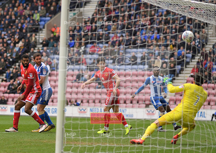 07/04/2018 Sky Bet League 1 Wigan Athletic v MK Dons<br /> <br /> Will Grigg headers ave by Lee Nicholls