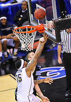 Nasir Robinson of the Panthers is fouled going for a layup. Pittsburgh defeated UNC-Asheville 74-51 during the NCAA tournament at the Verizon Center in Washington, D.C. on Thursday, March 17, 2011. Alan P. Santos/DC Sports Box