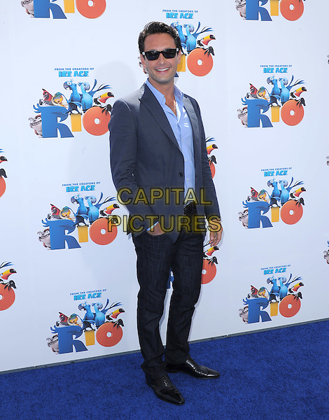 "RODRIGO SANTORO .at The Twentieth Century Fox and Blue Sky Studios L.A. Premiere of ""RIO"" held at The Grauman's Chinese Theatre in Los Angeles, California, USA, .April 10th 2011..full length jacket sunglasses jeans blazer  grey gray blue shirt .CAP/RKE/DVS.©DVS/RockinExposures/Capital Pictures."
