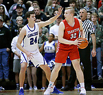February 28, 2020; Yankton at St. Thomas More High School Basketball -- Matthew Mors #32 of Yankton looks past St. Thomas More defender Ryder Kirsch #24 during their game Friday evening at Barnett Arena in Rapid City, S.D.(Photo by Richard Carlson/Inertia)