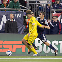 Columbus Crew defender Chad Marshall (14) intercepts pass forward as second half substitute New England Revolution forward Rajko Lekic (10) struggles to gain possession. In a Major League Soccer (MLS) match, the Columbus Crew defeated the New England Revolution, 3-0, at Gillette Stadium on October 15, 2011.