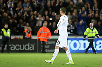 Gylfi Sigurdsson of Swansea City looks towards the celebrating Tottenham fans as he  leaves the field after the final whistle of the Premier League match between Swansea City and Tottenham Hotspur at The Liberty Stadium, Swansea, Wales, UK. Wednesday 05 April 2017