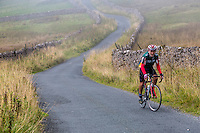 UK, England.  Rider Cycling in the Yorkshire Dales in Autumn.