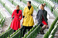 29/9/2010. Marks and Spencer's new Autumn Winter Fashion Collection. Model Jude Nabney is pictured wearing a black polo neck EUR20, red frill collar trench coat EUR109 and black leggings EUR27 , Model Baiba Gaile is pictured wearing a black polo neck EUR20, yellow rain mac EUR54 and jersey skirt EUR40, Model Nikki Bonass is pictured wearing a grey jersey coat EUR109 and a ribbed jersey skirt EUR35 at the Aviva stadium, Dublin for the launch of Marks and Spencer's new Autumn Winter Fashion Collection. Picture James Horan/Collins Photos