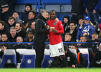 Manchester United Manager, Ole Gunnar Solskjaer hugs recent signing, Odion Ighalo just prior to him coming on as a second half substitute during Chelsea vs Manchester United, Premier League Football at Stamford Bridge on 17th February 2020