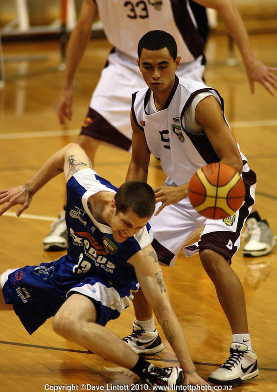 Saints import Eric Devendorf goes down under pressure from Houston O'Reilly during the National Basketball League match between the Wellington Saints and Harbour Heat at TSB Bank Arena, Wellington, New Zealand on Thursday, 29 April 2010. Photo: Dave Lintott / lintottphoto.co.nz