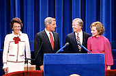 United States President Jimmy Carter, center right, and US Vice President Walter Mondale, center left, and their wives, first lady Rosalynn Carter, right, and Joan Mondale, left, on the podium after delivering their acceptance speeches at the 1980 Democratic National Convention in Madison Square Garden in New York, New York on August 13, 1980.<br /> Credit: Arnie Sachs / CNP