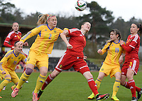 20150404 - FORST , GERMANY  : heading duel pictured between Ukrainian Tetiana Levytska (2) and Belgian Bieke Vandenbussche (right) during the soccer match between Women Under 19 teams of Belgium and Ukraine , on the first matchday in group 5 of the UEFA Elite Round Women Under 19 at WaldseeStadion , Forst , Germany . Saturday 4th April 2015 . PHOTO DAVID CATRY