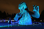 July 18, 2014, Tokyo, Japan - A visitor looks at a 6.6 meter tall replica model of Godzilla at Tokyo Midtown in downtown Tokyo on Friday, July 18, 2014. The Godzilla display runs from July 18 to August 31. (Photo by AFLO)