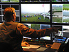 FOX Sports Director J. Bryan Lilley oversees a live broadcast from the control room of the media outlet's production trailer during a practice round of the U.S. Open Championship at at Shinnecock Hills Golf Club in Southampton on Wednesday, June 13, 2018.