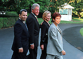 Washington, DC - July 15, 1999 -- Baraks and Clintons walk to Marine 1 en route to Camp David, MD on Thursday, 15 July, 1999..From left to right: Prime Minister Ehud Barak of Israel, United States President Bill Clinton, U.S. First Lady Hillary Rodham Clinton, and Mrs. Ehud (Nava) Barak..Credit: Ron Sachs / CNP