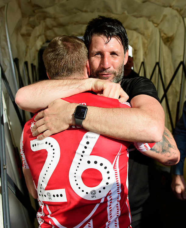 Lincoln City manager Danny Cowley, right, hugs Lincoln City's Harry Anderson as they celebrate winning the league<br /> <br /> Photographer Chris Vaughan/CameraSport<br /> <br /> The EFL Sky Bet League Two - Lincoln City v Tranmere Rovers - Monday 22nd April 2019 - Sincil Bank - Lincoln<br /> <br /> World Copyright © 2019 CameraSport. All rights reserved. 43 Linden Ave. Countesthorpe. Leicester. England. LE8 5PG - Tel: +44 (0) 116 277 4147 - admin@camerasport.com - www.camerasport.com