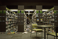 Fallen books litter the aisles of the Napa Public Library after a 6.1 magnitude earthquake hit the San Francisco Bay Area at 3:20 am, in Napa, California, USA, 24 August 2014. More than 70 people were sent to hospital with injuries and power outages darkened multiple cities in northern California after a 6.1-magnitude earthquake struck early on 24 August. The United States Geological Survey (USGS) said the earthquake struck at 3:20 am (1020 GMT) at a depth of 10.8 kilometres. It was located nine kilometres south-west of the Napa wine region, and 81 kilometres north of San Francisco.