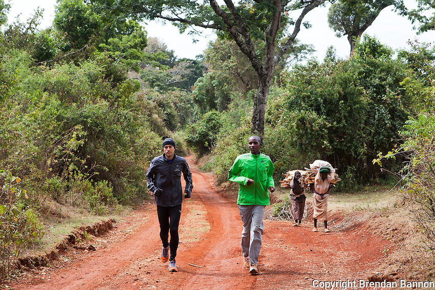 Ioannis Magkriotellis, left, a Greek marathon runner training in Iten with Kenyan Johanna Kariankei. Magkriotellis is hoping to improve his time  enough through high-altitude training to qualify for  the Olympics on Greece's team. International athletes have flocked to Iten hoping to gain  advantage from training with the world's fastest  distance runners at high altitude.