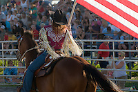 Johnsville, MD: J Bar W Ranch -- Amy Albright makes stadium entrance for the beginning of the Saturday night rodeo,