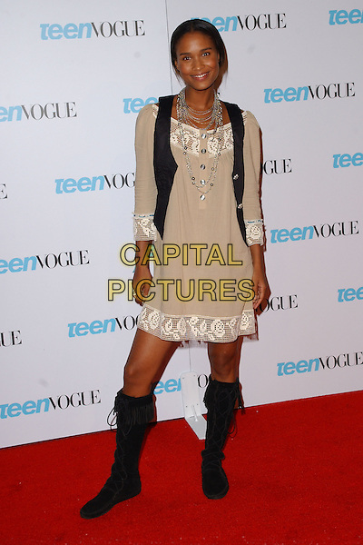 """JOY BRYANT.Teen Vogue Celebrates """"Young Hollywood Issue"""" held at the Hollywood Roosevelt Hotel,.Los Angeles, 20thn September 2005.full length cream beige dress black waistcoat boots brown.Ref: DVS.www.capitalpictures.com.sales@capitalpictures.com.Supplied By Capital PIctures"""