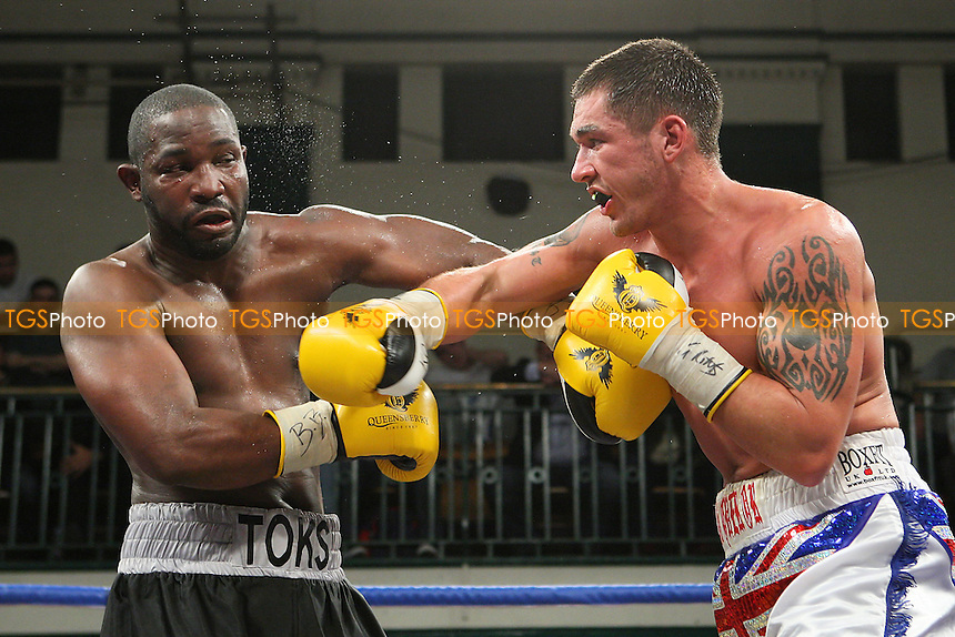 Tony Conquest (white shorts) defeats Toks Owoh in a Cruiserweight boxing contest for the Southern Area Title at York Hall, Bethnal Green, promoted by Queensberry Promotions - 18/11/11 - MANDATORY CREDIT: Gavin Ellis/TGSPHOTO - Self billing applies where appropriate - 0845 094 6026 - contact@tgsphoto.co.uk - NO UNPAID USE.