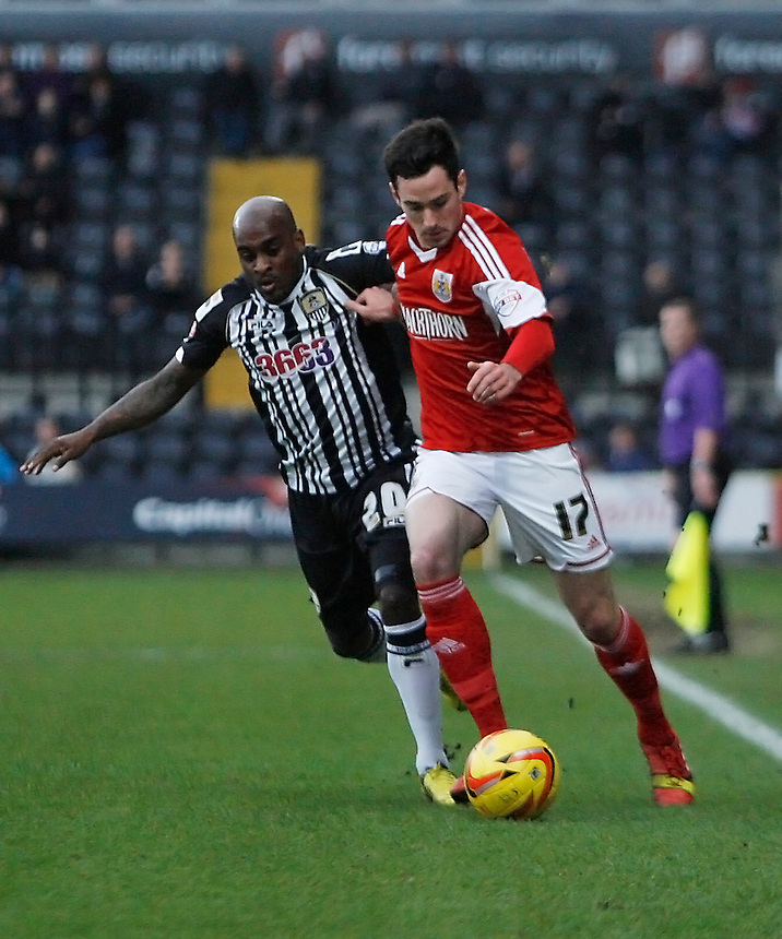 Bristol City's Greg Cunningham (R) and Notts County's Jamal Campbell-Ryce in action during todays match  <br /> <br /> Photo by Jack Phillips/CameraSport<br /> <br /> Football - The Football League Sky Bet League One - Notts County v Bristol City - Saturday 21st December 2013 - Meadow Lane - Nottingham<br /> <br /> &copy; CameraSport - 43 Linden Ave. Countesthorpe. Leicester. England. LE8 5PG - Tel: +44 (0) 116 277 4147 - admin@camerasport.com - www.camerasport.com