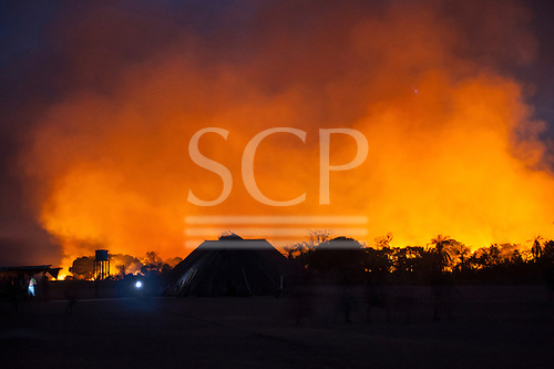 Xingu Indigenous Park, Mato Grosso, Brazil. Aldeia Matipu. Fire in the cerrados  forest dangerously close to the village.