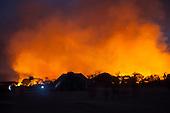 Xingu Indigenous Park, Mato Grosso, Brazil. Aldeia Matipu. Fire in the cerrados  forest dangerously close to the village.