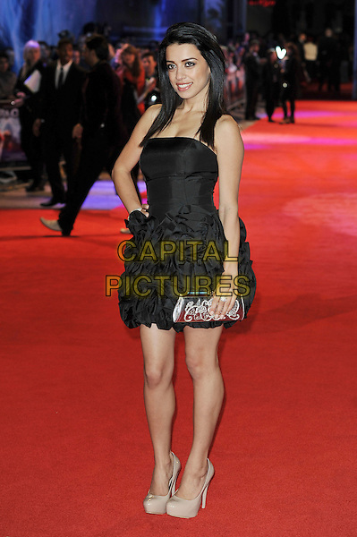 Jasmin May.'RA. One' UK premiere at Cineworld, O2 Arena, Greenwich, London, England..25th October 2011.full length black dress ruffle hand on hip clutch bag silver gathered beige shoes .CAP/MAR.© Martin Harris/Capital Pictures.