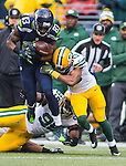 Seattle Seahawks  wide receiver Richardo Lockett (83) is tackled by Green Bay Packers linebacker Mike Neal and cornerback Tramon Williams (38) during the NFC Championship game at CenturyLink Field in Seattle, Washington on January 18, 2015.  The Seattle Seahawks beat the Green Bay Packers in overtime 28-22 for the NFC Championship Seattle. ©2015. Jim Bryant Photo. All Rights Reserved.