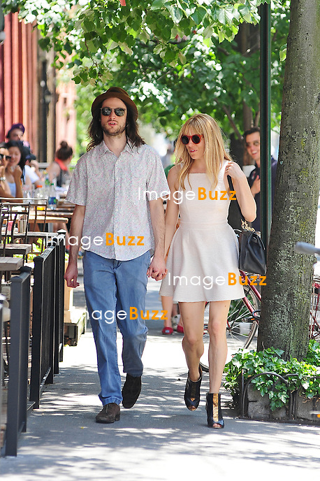 Sienna Miller and Tom Sturridge strolling in New York City on May 31, 2013.