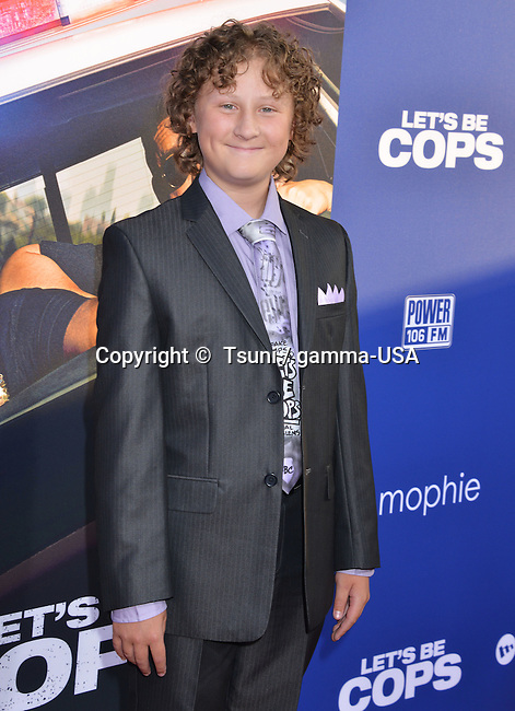 Joshua Ormond at the Let s Be Cops premiere at the Arclight Theatre in Los Angeles.
