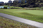 A path around golf course greens surrounded by multi floored condos in Branson Missouri